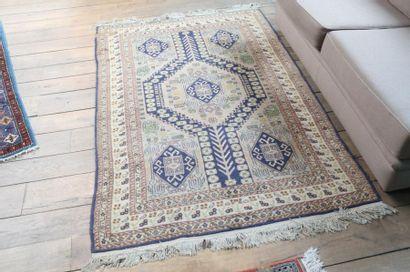 Deux tapis persans à motifs géométriques,...