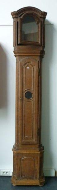 Horloge de parquet en chêne à décor sculpté,...