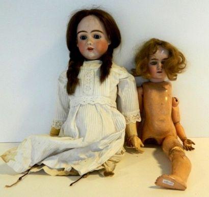 Deux poupées allemandes, tête porcelaine,...