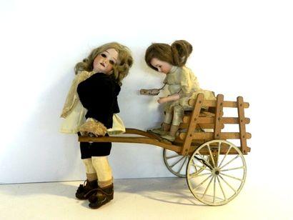 Rare jouet automate comprenant : 1 charrette...
