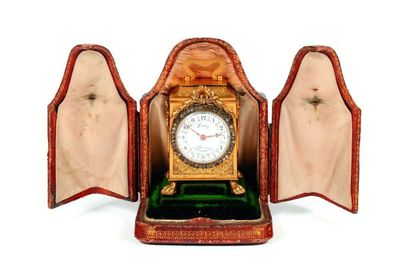 Pendulette de voyage miniature, en bronze...