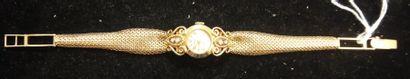 Montre-bracelet de dame en or jaune, le cadran...