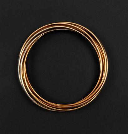 Bracelet dit semainier trois ors 18K (750°/00)...