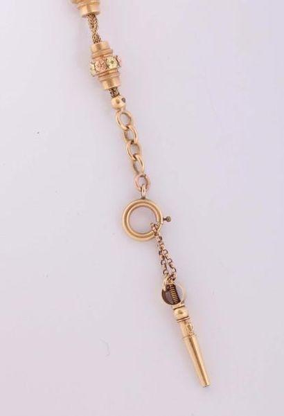Chaîne de montre en or de deux couleurs (pb....
