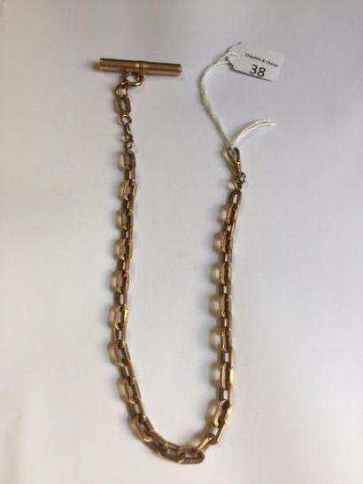 Chaîne de montre en or avec sa clé en or...
