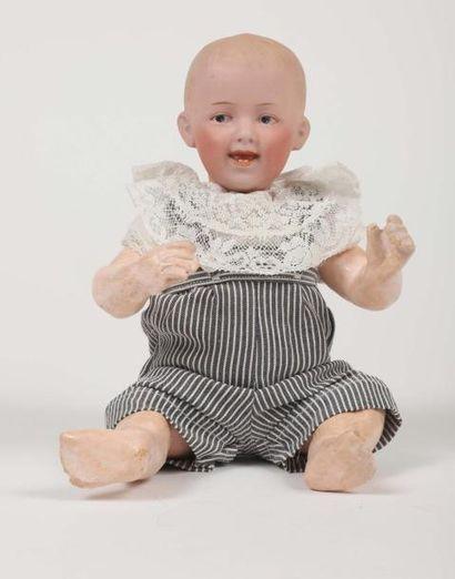 Bébé caractère Allemand, tête pleine en porcelaine,...