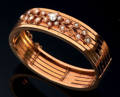 Bracelet jonc ajouré en or jaune 18K (750°/00)...