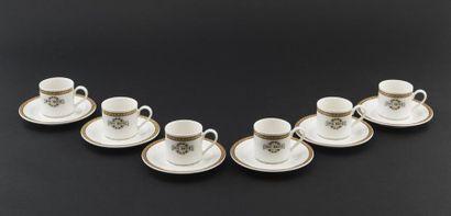 Six tasses et sous tasses à café en porcelaine,...
