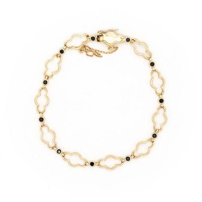 Bracelet en or jaune (750) 18K maillons polylobés...