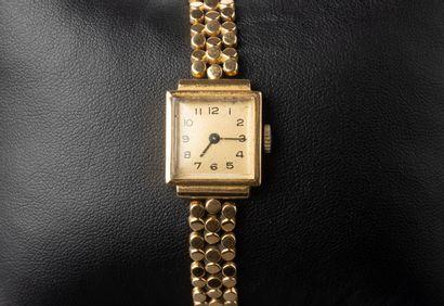 Montre de dame en or jaune bracelet articulé...