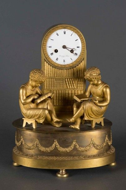 Pendule borne en bronze doré ciselé et doré...