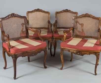 Suite de quatre fauteuils à dos plats en...