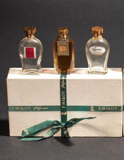 F.MILLOT Coffret contenant 3 flacons en verre,...