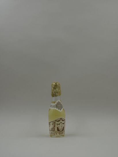 CARON « Royal bain de champagne »  Flacon en verre, panse figurant une bouteille...