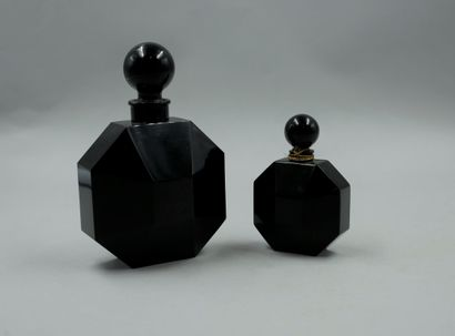"""D'ORSAY """"The Dandy  Set of two black crystal bottles, gold and titled labels. Ball-shaped..."""