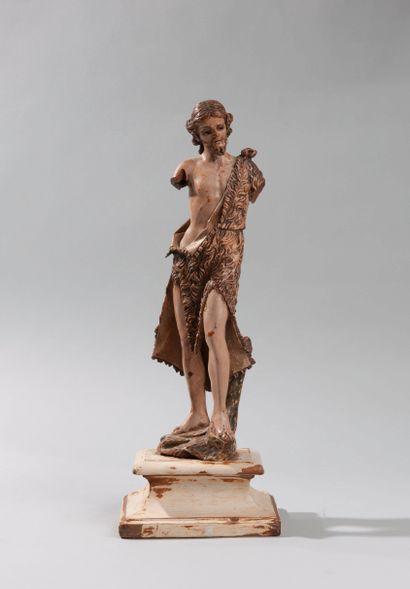 Sculpture en bois polychrome représentant saint Jean Baptiste vêtu d'une melotte....