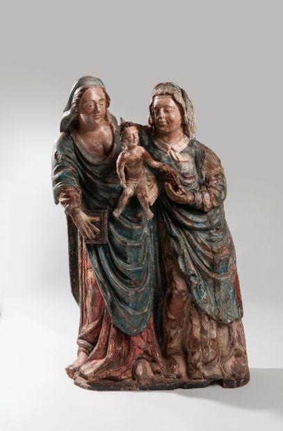 Groupe sculpté en bois polychrome représentant...