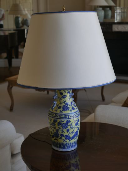 CHINA, 20th century. A baluster-shaped lamp base decorated in blue on a yellow background...