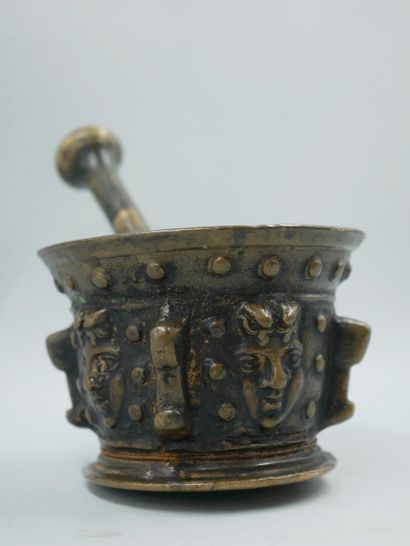 Bronze mortar with a medal patina and decorated with mascarons in relief. Height:...