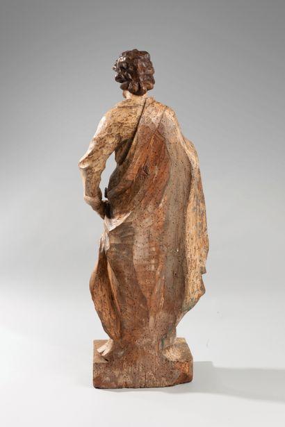 Sculpture en bois polychrome représentant saint Barthelemy. Le saint drapé d'un...