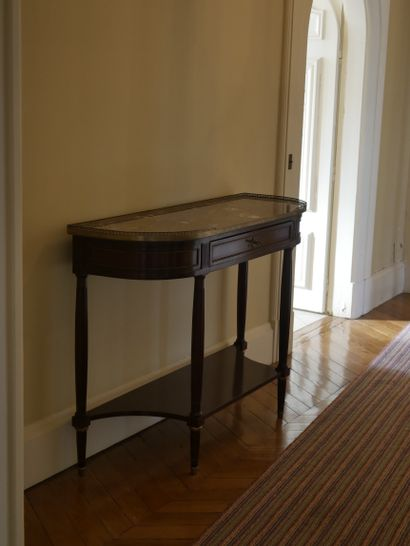 A Louis XVI style mahogany and mahogany veneer console table opening to a drawer...
