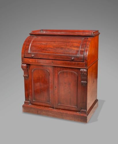 A mahogany and mahogany veneer cylinder desk opening to two valances, the top of...