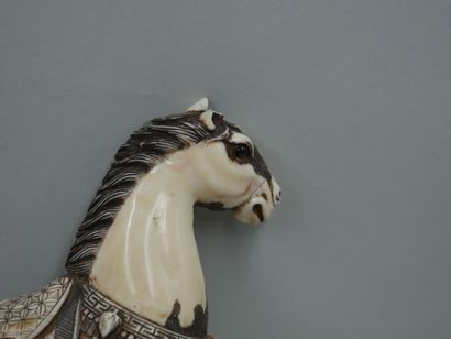 Japan. 20th century. Pair of carved ivory sculptures representing horses. Broken...