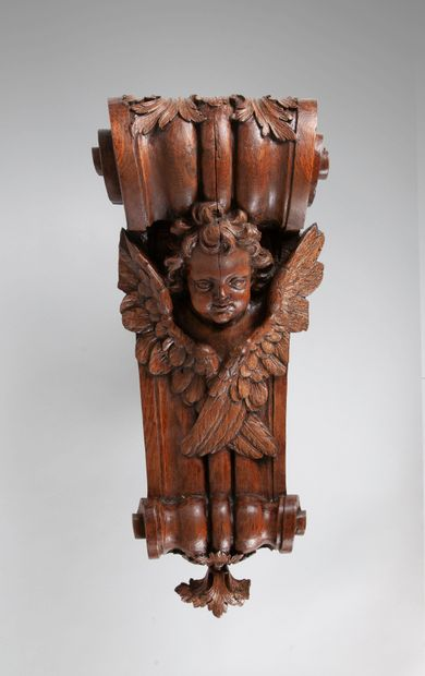 Console en chêne sculpté en forme de volute...