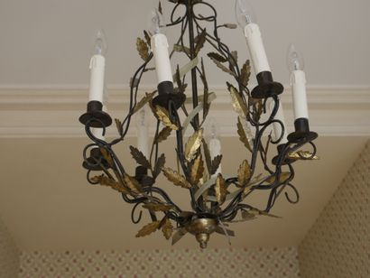 Green and gold lacquered sheet metal chandelier with eight arms of light decorated...