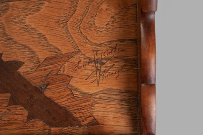 Emile GALLE (1846-1904). Marquetry serving tray decorated with a thistle and a cross...