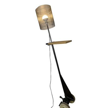 Two floor lamps in black lacquered metal and wood. Height 175cm. Worn