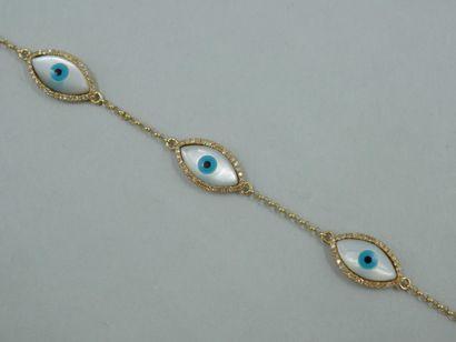 Bracelet en or jaune 18K orné de cinq yeux...