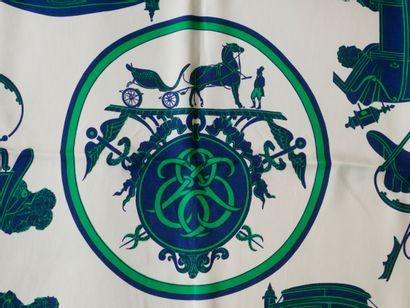 """HERMES Paris. Carré en soie """"Calèche"""" à décor dans les tons bleu et vert. Signé...."""