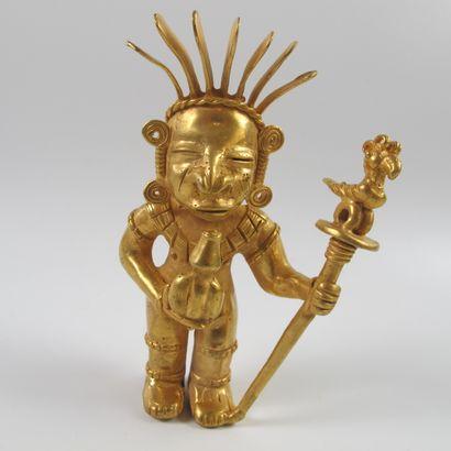 Statuette de chaman debout au vase rituel...