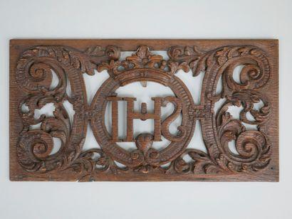 Elément rectangulaire en bois sculpté ajouré...