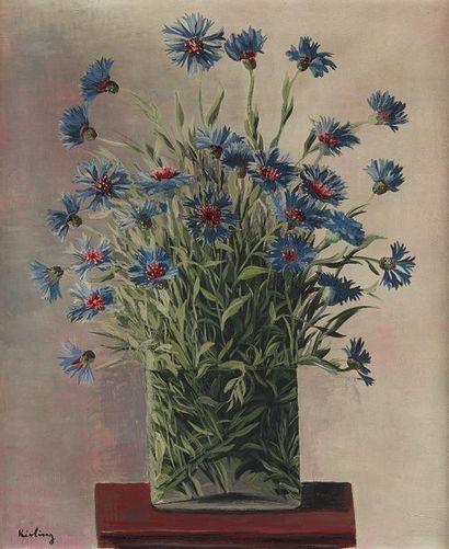 Moïse KISLING (1891-1953) Les bleuets, 1928. Huile sur toile signée en bas à gauche....