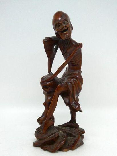 JAPON    Sujet en bois figurant un vieillard...