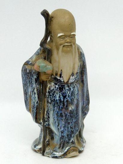 CHINE    Sujet en terre cuite vernissée figurant...
