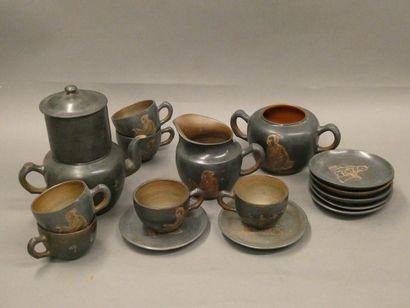 Service à thé en terre cuite comprenant une...