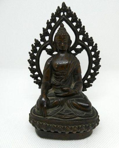 CHINE    Petite statuette de Bouddha en bronze.    H. : 15 cm