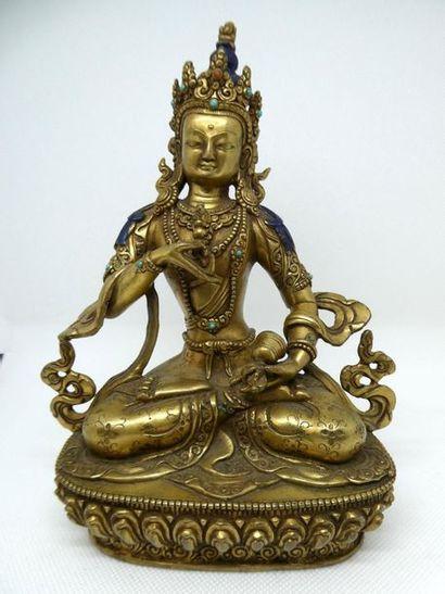 CHINE Bouddha en bronze doré et partiellement...