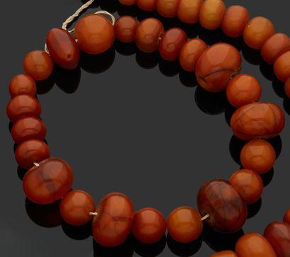 COLLIER de perles d'ambre présumé en chute....