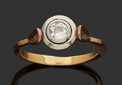 RING in 18K (750) yellow and white gold set...