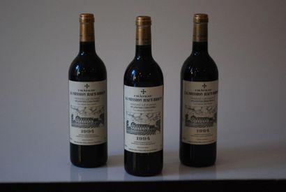 Trois bouteilles de Château La Mission Haut...
