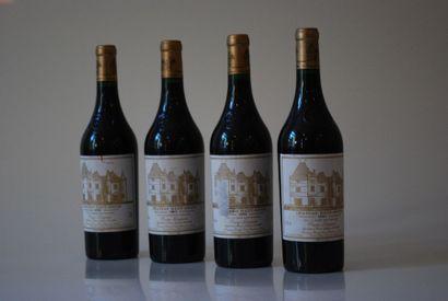Quatre bouteilles de Château Haut Brion 1994,...