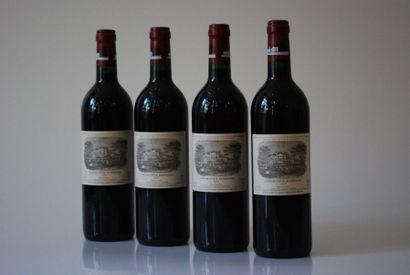 Quatre bouteilles de Château Lafite Rothshild...