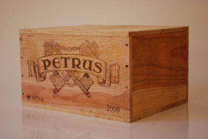 Une caisse de six bouteilles de Petrus 2000,...