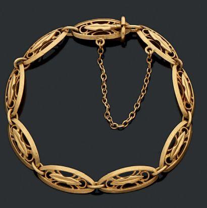 Bracelet en or jaune (18k) à motif ajouré...