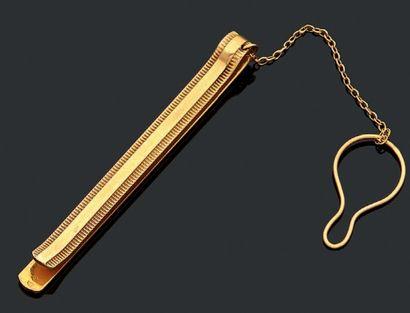 Pince à cravate en or (18k). Poids 7,49 ...
