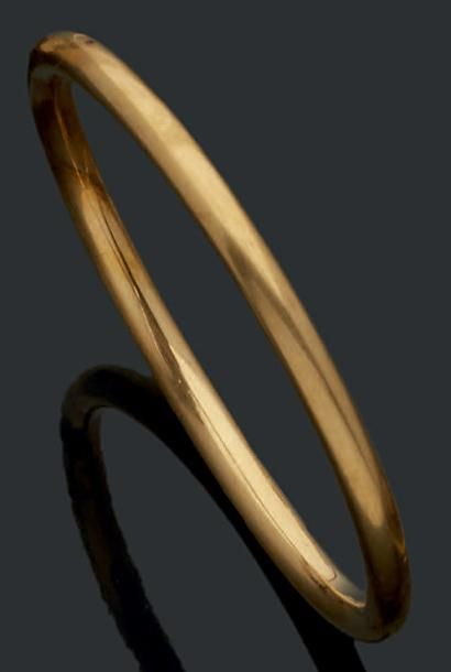 Bracelet jonc en or jaune 18K (750) de forme...
